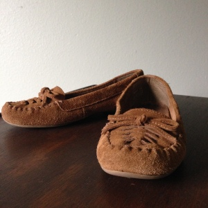 Minnetonka moccasins in classic brown.