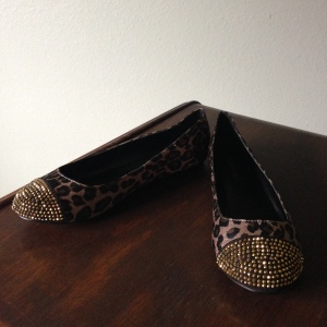 Leopard round toe flat with copper crystal toe cap.