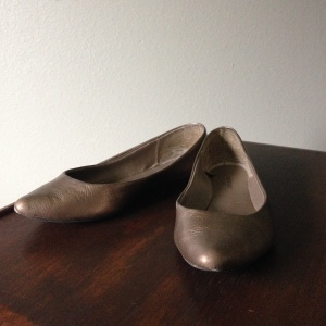 Pointy toe flats in a metallic neutral.